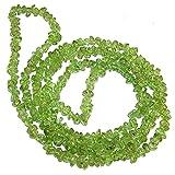 Collar Largo de Olivina multitud de Piezas Irregulares. Longitud Collar 85-90 cm. Olivina es la piedra de la fidelidad. Bolsa de tela regalo