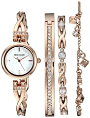 """Mineral crystal lens; mother-of-pearl dial with rose gold-tone hands and markers; rose gold-tone """"x"""" shaped bracelet accented with 24 clear swarovski crystals; jewelry clasp and extender Set includes three swarovski crystal accented rose gold-tone br..."""
