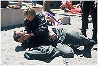 Stargate Amanda Tapping as Col. Carter holding head of Richard Dean Anderson as Col. O'Neill 8 x 10 Inch photo
