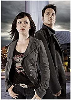 Torchwood John Barrowman is Captain Jack with Eve Myles as Gwen Cooper Looking On 8 x 10 Photo