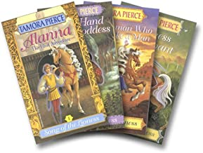 By Tamora Pierce The Song of the Lioness Quartet: Alanna: The First Adventure / In the Hand of the Goddess / The Woma [Paperback]