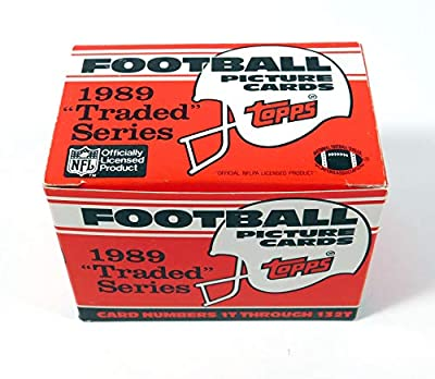 1989 Topps Traded Football Complete Mint 132 Card Set in Original Factory Set Box. Featuring Rookie Cards of Barry Sanders, Troy Aikman, Derrick Thomas, Deion Sanders and Many Others!