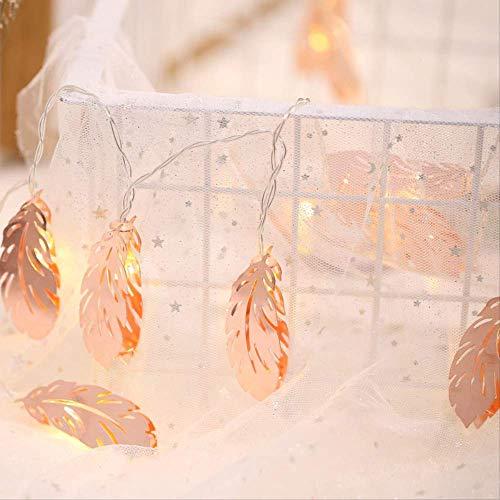 Meisjeskamer versierd met roségouden veer lamp touw lantaarns voor slaapkamers