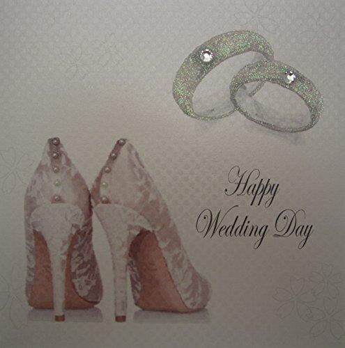 White Cotton Cards huwelijksringen en bruidsschoenen