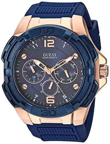 GUESS Relógio de silicone grande emblemático rosa dourado azul resistente a manchas com dia, data + 24 horas militar/hora Internacional. Cor: Azul icônico (modelo: U1254G3)
