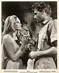 Ursula Andress and John Richardson in She