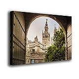 Desconocido Cuadro Lienzo Canvas La Giralda de Sevilla Vista a través de una Puerta Andalucia – Varias Medidas - Lienzo de Tela Bastidor de Madera de 3 cm - Impresion Alta resolucion (50, 33)