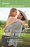 The Rancher's Fake Fiancée: A Clean Romance (Return of the Blackwell Brothers Book 4) (English Edition)