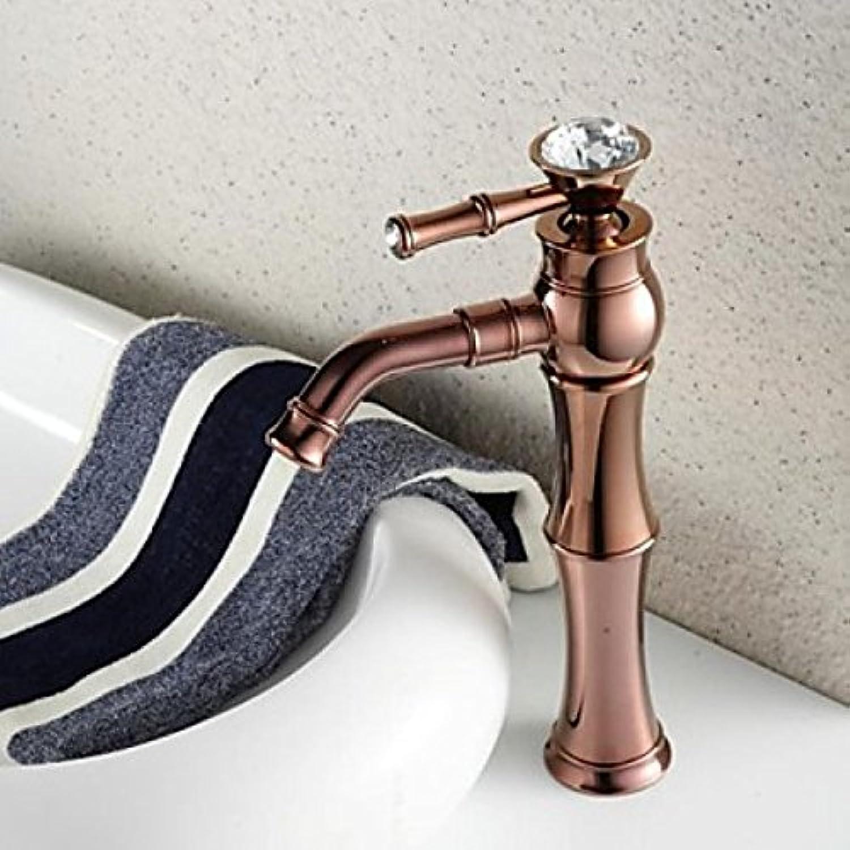 Robinet de lavabo à la forme ronde finition or pink et pierre