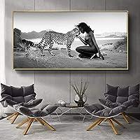 雪ヒョウと女性のポスターとプリント自然の風景壁アートパネル白黒キャンバス絵画インテリア写真リビングルームの家の装飾50x100cmフレームなし