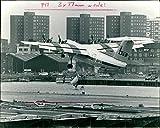 Fotomax - Foto Vintage del Aeropuerto de Londres y ferrocarril: Dash 7 Stol