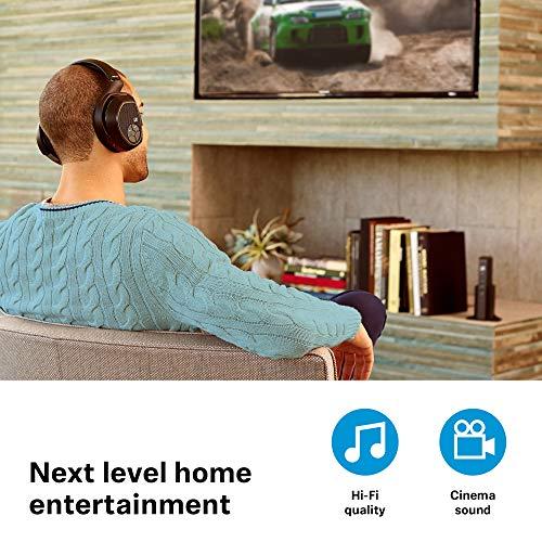 man watching a movie wearing a Sennheiser RS 175 RF headphones