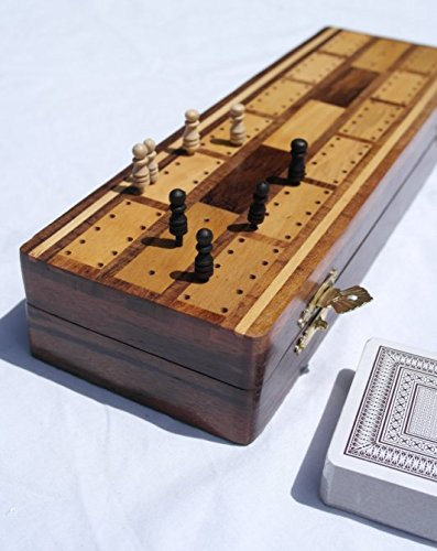 Wooden cribbage board with pegs and two packs of playing cards by Thorness