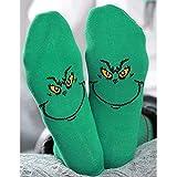 El monstruo peludo verde con calcetines y medias de tubo