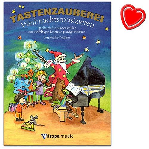 Tastenzauberei Weihnachtsmusizieren - Spielbuch für Klavier von A. Drabon mit vielfätigen Besetzungsmöglichkeiten : solo, vierhändig, Klavier, C-Instr, Gesang (+ herzförmiger Notenklammer)
