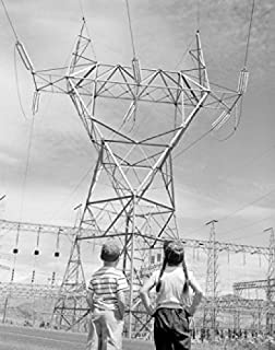 Posterazzi Boy and girl looking at electricity pylon Poster Print (18 x 24)