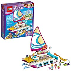 Build your own Sunshine Catamaran, complete with sun deck with two sun loungers, pool, water slide, bridge with steering controls, spiral stairs up from the water and more! Includes Olivia, Stephanie and Liam mini-dolls, plus Sheen and Sapphire the d...