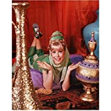Barbara Eden 8 Inch x10 Inch Photo I Dream of Jeannie 7 Faces of Dr. Lao Harper Valley P.T.A. Wearing Green Costume Lying Down Red Curtain in Background kn