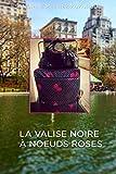 La valise noire à noeuds roses