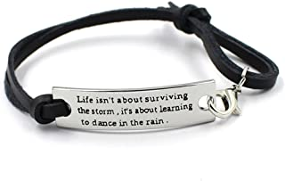 """YOYONY stamped """"Life isn't about surviving the storm.."""" inspirational bracelet with leather strap"""