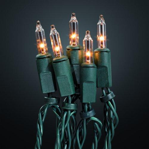 HELLUM 500417 40-teilige Mini-Lichterkette für außen, klare Pisellokerze mit Stecksockel, inkl. Ersatzlämpchen, Fassungsabstand 15 cm, Gesamtlänge 15,85 m, davon 10 m grünes Zuleitungskabel