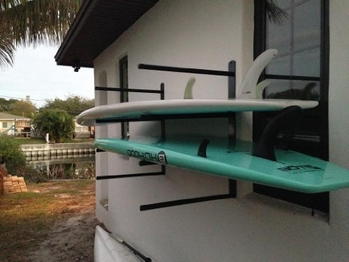 T-Rax SUP 4 Board Wall Rack 3 SUP 4 board storage wall rack. Extremely heavy duty! Lifetime guarantee. Made in the U.S.A. All stainless steel hardware included. High quality UV rated foam padding.