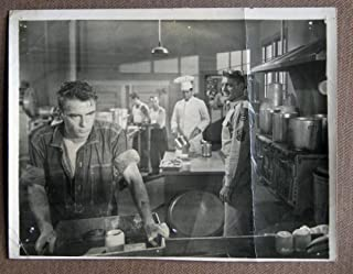 DN2 From Here To Eternity MONTGOMERY CLIFT Studio Still.  Here's a terrific Original Studio Still  from the original release of FROM HERE TO ETERNITY featuring a great image of MONTGOMERY CLIFT and BURT LANCASTER.Studio Still  is in GOOD+ condition. Multiple pinholes in the corners, no stains, no tears, a center vertical fold, the bottom border is trimmed one-half inch.