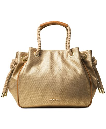 Casual goes couture with this capacious Dalia tote flaunting a relaxed shape and nautical inspiration that's ready for both weekends at home or on vacation. Cotton canvas. Gold-tone hardware. Magnetic snap closure. Polyester lining. Zip pocket and 6 ...