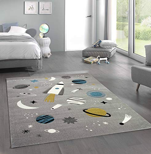 Space Learning rug with spaceship stars and planets