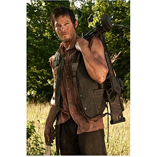 Norman Reedus in The Walking Dead as Daryl Dixon Dressed in Brown Cutoff Shirt and Vest with Knife and Bow and Arrow 8 x 10 Inch Photo