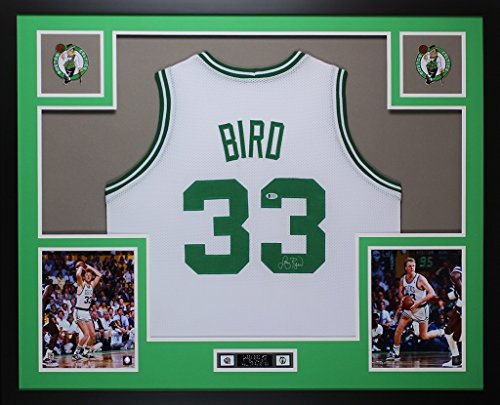 Larry Bird Autographed White Boston Celtics Jersey - Beautifully Matted and Framed - Hand Signed By Larry Bird and Certified Authentic by Beckett - Includes Certificate of Authenticity