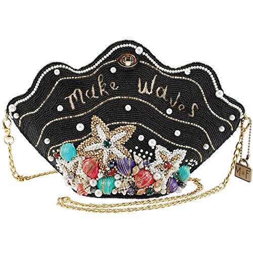 Inspired by Disney's The Little Mermaid, this Mary Frances handbag is a hand beaded clam shell shaped bag, adorned with pearls and shells. The phrase 'Make Waves' is embroidered across the front with wave like design movement integrated into the bead...