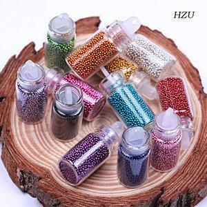 12 bouteilles aux couleurs variées Ongles Caviar de Boolavard 12 couleurs perles colorées nail art petites perles colorées perle de colle perle du Caviar manucure vernis