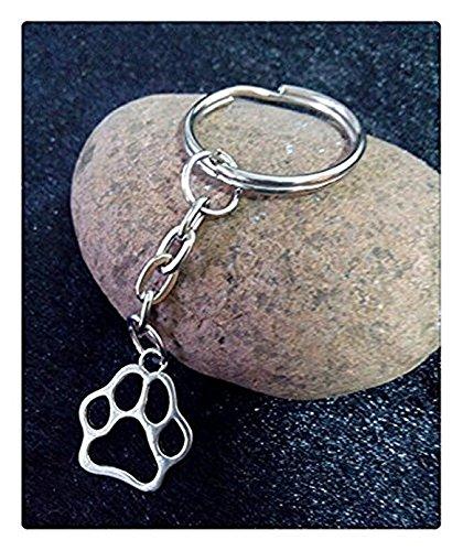 Llavero con diseño de huellas de perro y gato, con colgante de plata