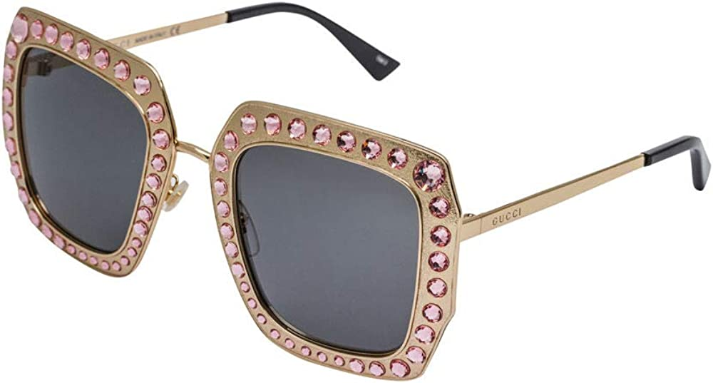 Gucci, occhiali da sole per donna , montatura in metallo dorato con pietre incastonate GG0115S
