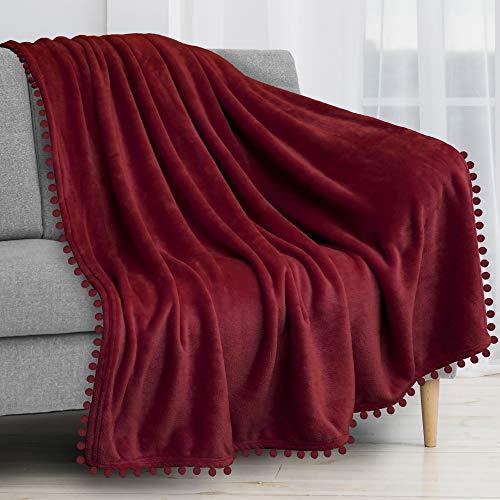 PAVILIA Pom Pom Blanket Throw Twin, Wine Dark Red | Soft Fleece Pompom Fringe Blanket for Couch Bed Sofa | Decorative Cozy Plush Warm Flannel Velvet Tassel Throw Blanket, 60x80