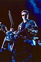 Arnold Schwarzenegger sitting on Harley Fat Boy with shotgun Terminator 2 24X36 Poster