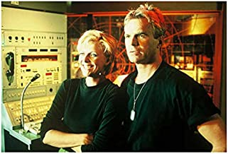 Stargate Richard Dean Anderson as Col. O'Neill with Amanda Tapping as Col. Carter smiling by control panel 8 x 10 Inch photo