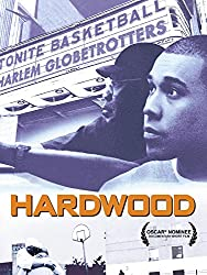 Image: Watch Hardwood | a personal journey by director Hubert Davis, the son of former Harlem Globetrotter Mel Davis, who explores how his father's decisions affected his life and those of his extended family