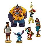 L'ensemble comprend 6 personnages détaillés Les personnages incluent Lilo avec Scrump, Stitch Nani, David, Jumba et Pleakley Détail de costumes colorés et bases de sable Figures individuelles H5-10cm env.