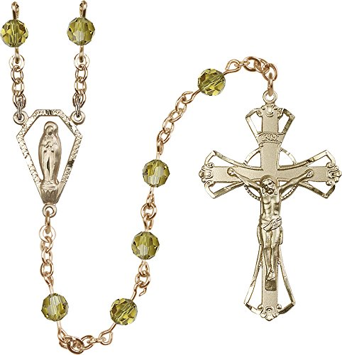 14Ct Gold Filled Rosary features 6mm Lime Swarovski beads. The Crucifix measures 1 3/4 x 1 1/8. The centerpiece features a Miraculous medal.