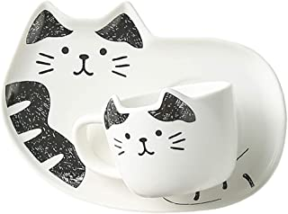 Set med kopp och liten bricka med kattmotiv.