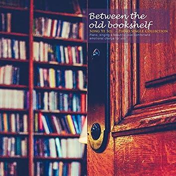 Between old bookshelves