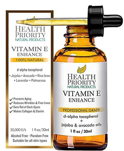 Huile à la vitamine E pour le visage et le corps 100% naturelle & bio, sans parfum - 15,000/30,000 IU. Cette huile légère, infusée avec des huiles de jojoba, d'avocat et de son de riz, pénètre facilement et adoucit votre peau. Elle favorise la production de collagène et d'élastine. Les rides sont visiblement réduites, les taches brunes sont atténuées, votre peau est rajeunie. Cette huile à la vitamine E est plus facile d'usage que les capsules. Obtenez les résultats dont vous avez toujours rêvé!