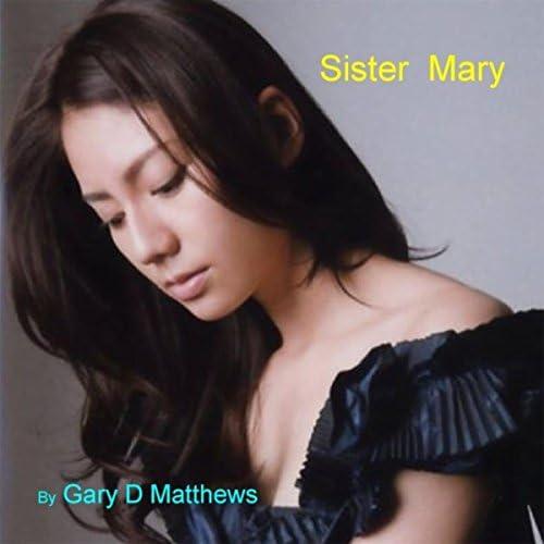 Gary D Matthews