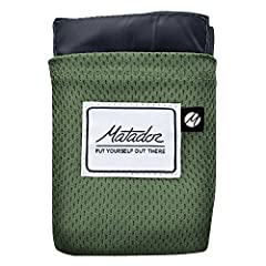 """Ultra Compact and Lightweight, folds out to a large 63""""x44"""" blanket Built-in Metal Ground Stakes (rust proof) for exceptional performance in wind, Sand Pocket Corners to keep blanket secure on beaches. Metal stakes store inside the blanket and act as..."""