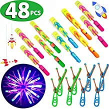 48 Pcs Light Up Rockets Holiday Toys for Boys Age 3-14, LED Helicopters Arrow Rocket Flying Toy Airplanes Outdoor Game Xmas Party Favors Glow In The Dark Party Supplies (24 Slingshot + 24 LED Rocket)