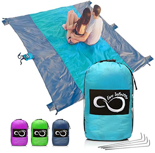 Sand Free Beach Blanket- 7 Person 9' x 10' Sand Proof Mat – Travel Friendly For Festivals & Hiking- Extremely Soft Quick Drying Heat Resistant Nylon- 4 Anchor Loops & Stakes Bright Blue