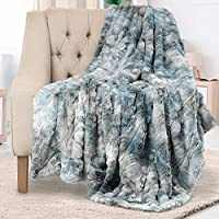 2 Luxurious Designs: Luxury runs through every stitch, seam, and thread of the Everlasting Comfort Throw Blanket. You'll experience opulence at its finest with its plush faux fur fabric wrapped around you. Our throw blanket features a faux animal pri...