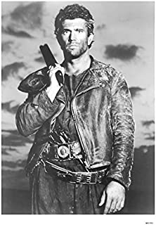 Mel Gibson with gun resting on shoulder Mad Max Beyond Thunderdome 8 x 10 Inch Photo